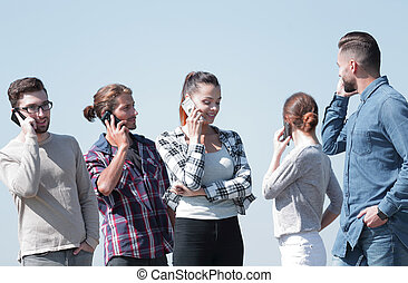 young people talking on their smartphones. - group of young ...