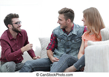 group of young people talking sitting on the couch