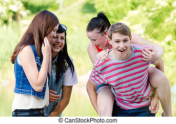 group of young people teenage friends happy smiling & looking at camera having fun outdoors portrait
