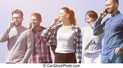 group of young people with smartphones