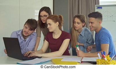 Group of young people works at the office