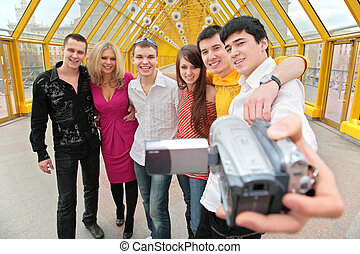 group of young persons removes itself to video camera on...