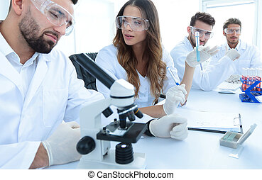 group of young scientists discussing the results of a study...