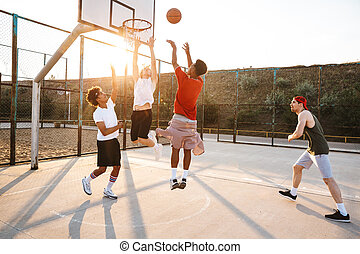 Group of young sporty multiethnic men basketball players ...