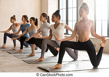 Group of young sporty women practicing yoga, doing Horse rider