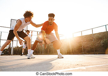 Group of young strong multiethnic men basketball players ...