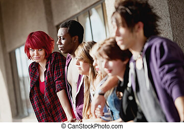 Group of young teens staring into distance.