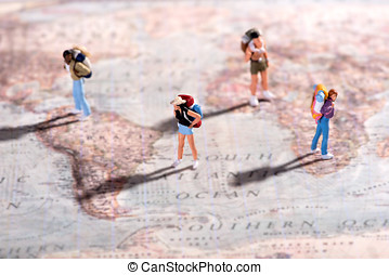 Group of young travellers on a world map