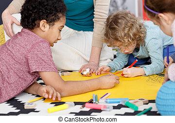 Group painting in kindergarten