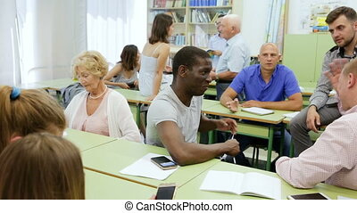 Group people discussion during business course - Group ...