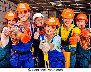 Group people in builder uniform. - Group people in blue...
