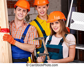 Group people in builder uniform. - Happy group people in...
