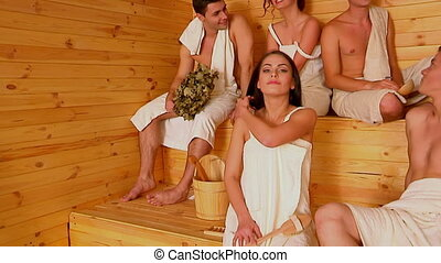 Group people in Santa hat at sauna. - Group people in hat...