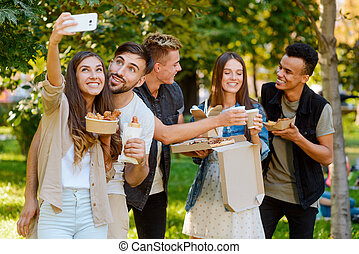 Group photo of friends, selfie concept. Young people in the park