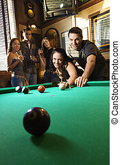 Group playing billiards.