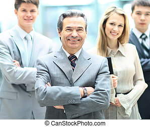 Group portrait of a professional business team looking