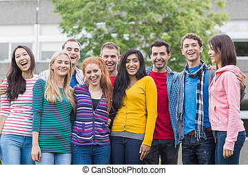 Group portrait of college students in park