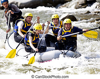 Group rowing on river - Group of happy people with guide...