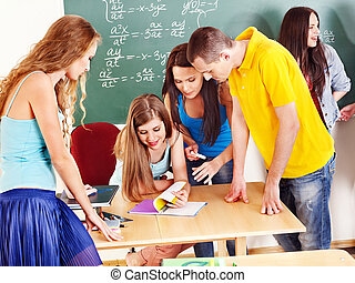 Group student near blackboard. - Group clever student near ...