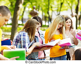 Group student with notebook outdoor.
