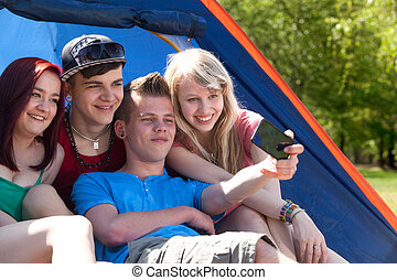 Group taking a picture in the tent - Young teeanger group...