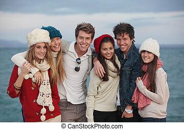 group teens - happy group of winter autumn teens