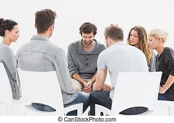 Group therapy in session sitting in