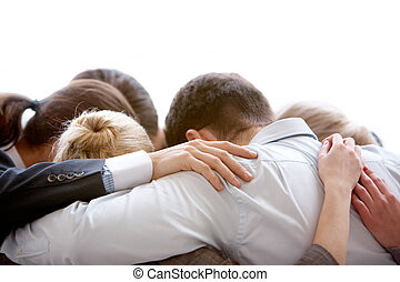 Group thinking - Circle of business people embracing each...