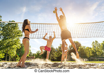 Group young  Friends Playing Volleyball On Beach