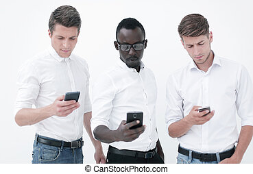 Group young multiethnic business people using mobile phones