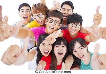 groupe, gens, haut, jeune, pouces, heureux
