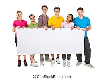 groupe gens, tenue, bannière