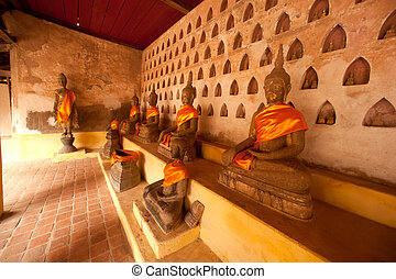 Groups of ancient Buddha on the wall of Church in Si Saket