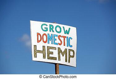 Grow domestic hemp sign at a rally.