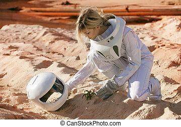 Grow plants on Mars, futuristic astronaut without a helmet, ...
