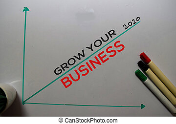 Grow Your Business 2020 write on white board background. Chart or mechanism concept