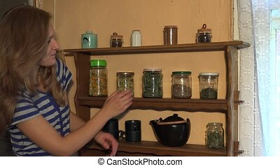 Grower woman smell mint herbs in jar and smile. Static shot....