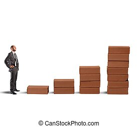 Growing business - Concept of businessman with statistics...