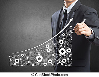 Growing economy by gears - Business man drawing growing...