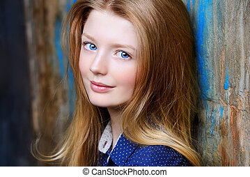 Portrait of a cute smiling teen girl looking at camera.