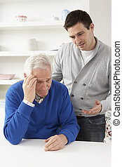 Grown Up Son Consoling Senior Parent