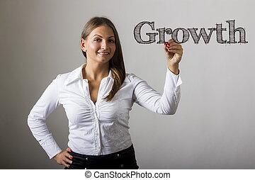 Growth - Beautiful girl writing on transparent surface