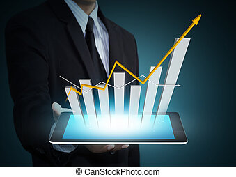 Business hand holding growth chart on tablet technology