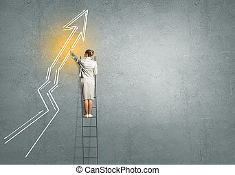 Growth concept - Rear view of businesswoman standing on...