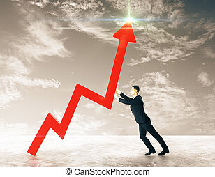 Growth concept - Side view of young businessman pushing red...
