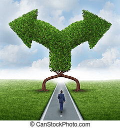 Growth direction choice business concept as a businessman walking on a road with two trees shaped as arrows pointing in different directions as a metaphor for a crossroad dilemma for a growing career or investment.