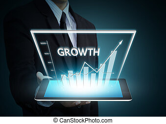 Growth graph on tablet technology - Business hand holding...