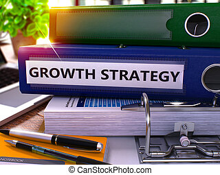 Growth Strategy on Blue Ring Binder. Blurred, Toned Image.