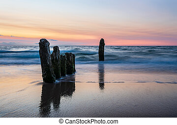 Groynes on shore of the Baltic Sea in Kuehlungsborn, Germany...