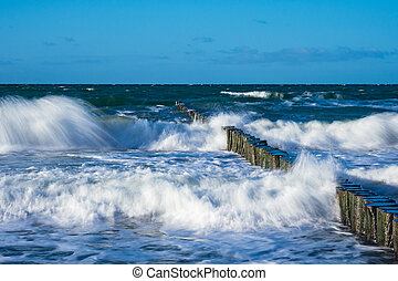 Groynes on shore of the Baltic Sea on a stormy day